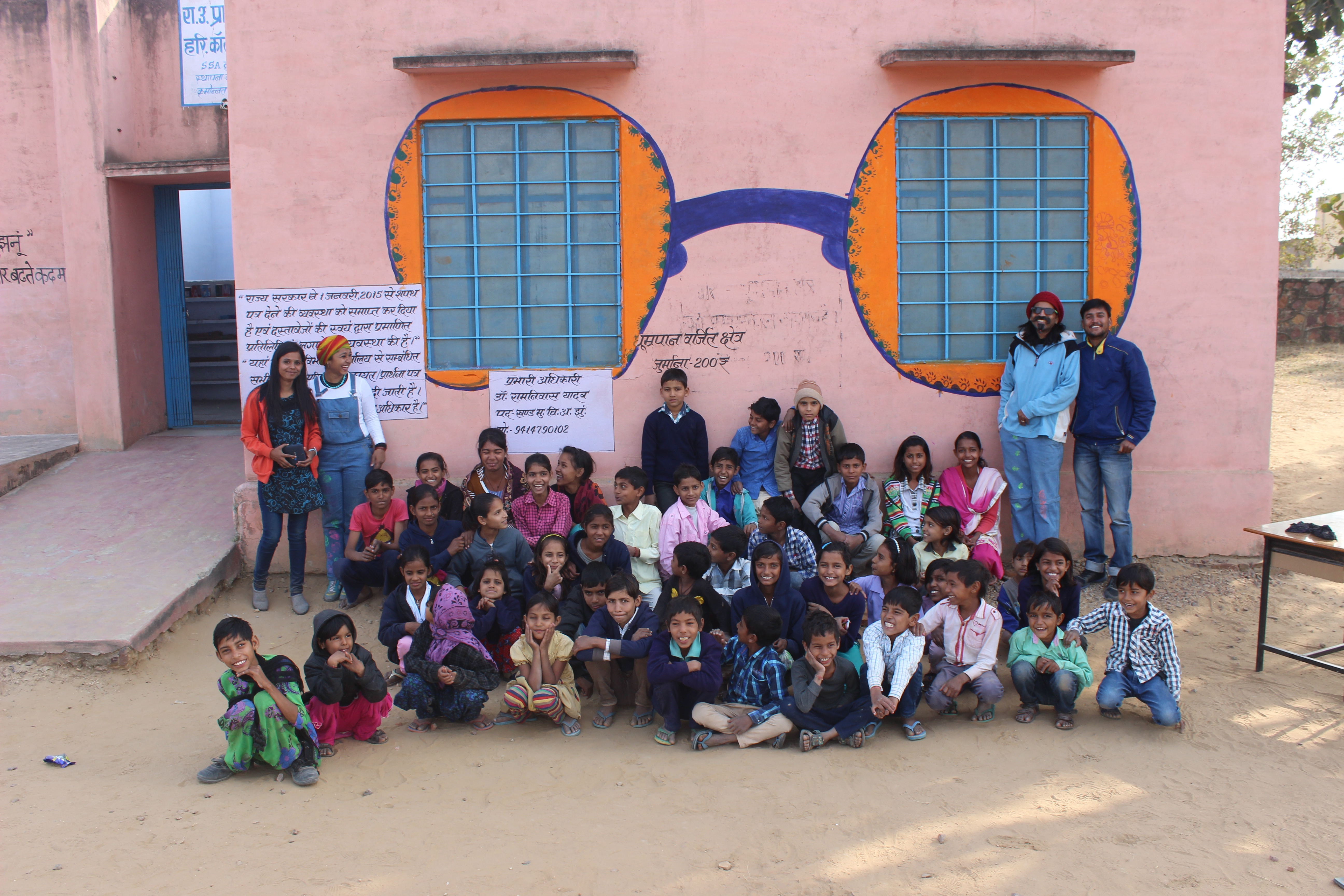 A mural on the wall painted with kids in a village school